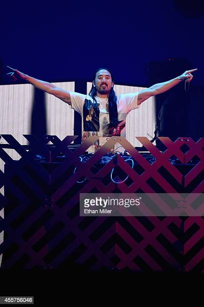 DJ/producer Steve Aoki performs onstage during the 2014 iHeartRadio Music Festival at the MGM Grand Garden Arena on September 19 2014 in Las Vegas...