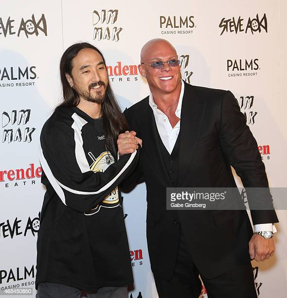DJ/producer Steve Aoki shakes hands with President and CEO of the Brenden Theatre Corp Johnny Brenden as they attend the Brenden Celebrity Star...