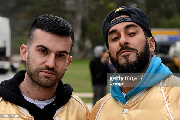 Producers ATrak and Armand Van Helden of Duck Sauce pose backstage during the 7th Annual Outside Lands Music Arts Festival at Golden Gate Park on...