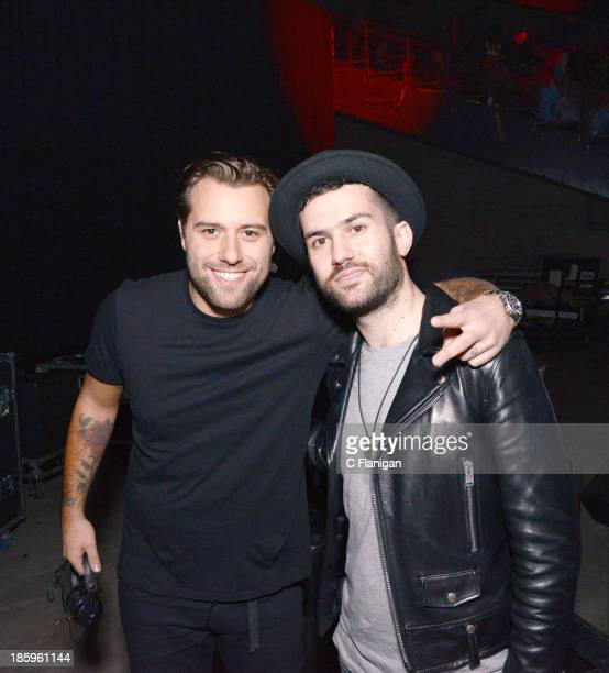 Producers Sebastian Ingrosso of Swedish House Mafia and ATrak pose backstage during Spookfest at ORACLE Arena on October 25 2013 in Oakland California