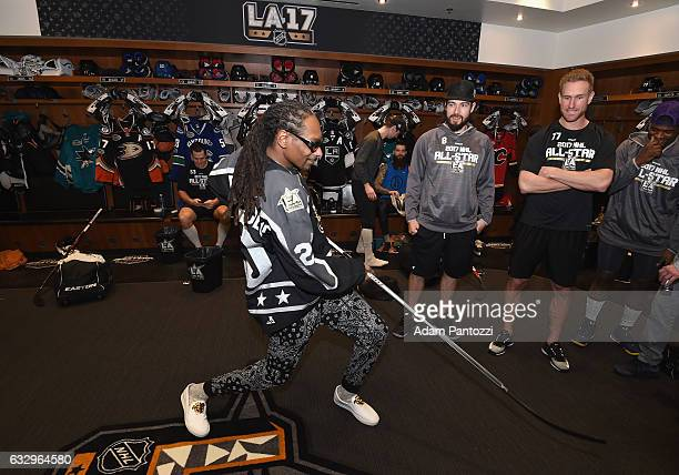 Rapper Snoop Dogg visits the locker room before the start of the 2017 Coors Light NHL AllStar Skills Competition at Staples Center on January 28 2017...