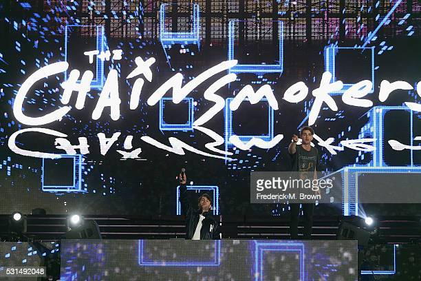 DJs Alex Pall and Andrew Taggart of The Chainsmokers perform on stage at KIIS FM's Wango Tango 2016 at StubHub Center on May 14 2016 in Carson...