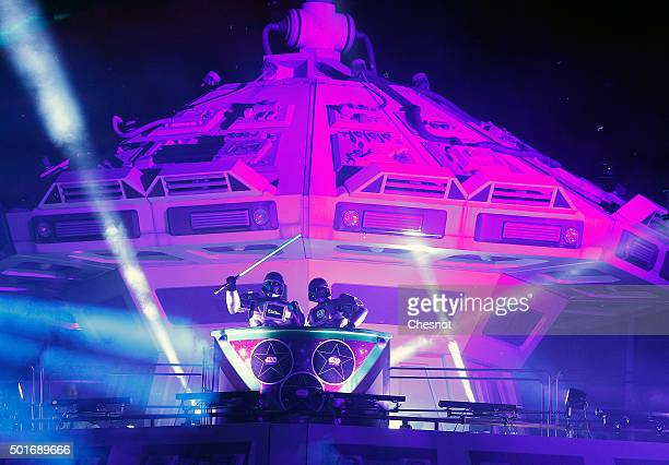 DJs dressed as a character from Star Wars The Force Awakens are seen during Star Wars Episode VII The Force Awakens party at Disneyland Paris on...