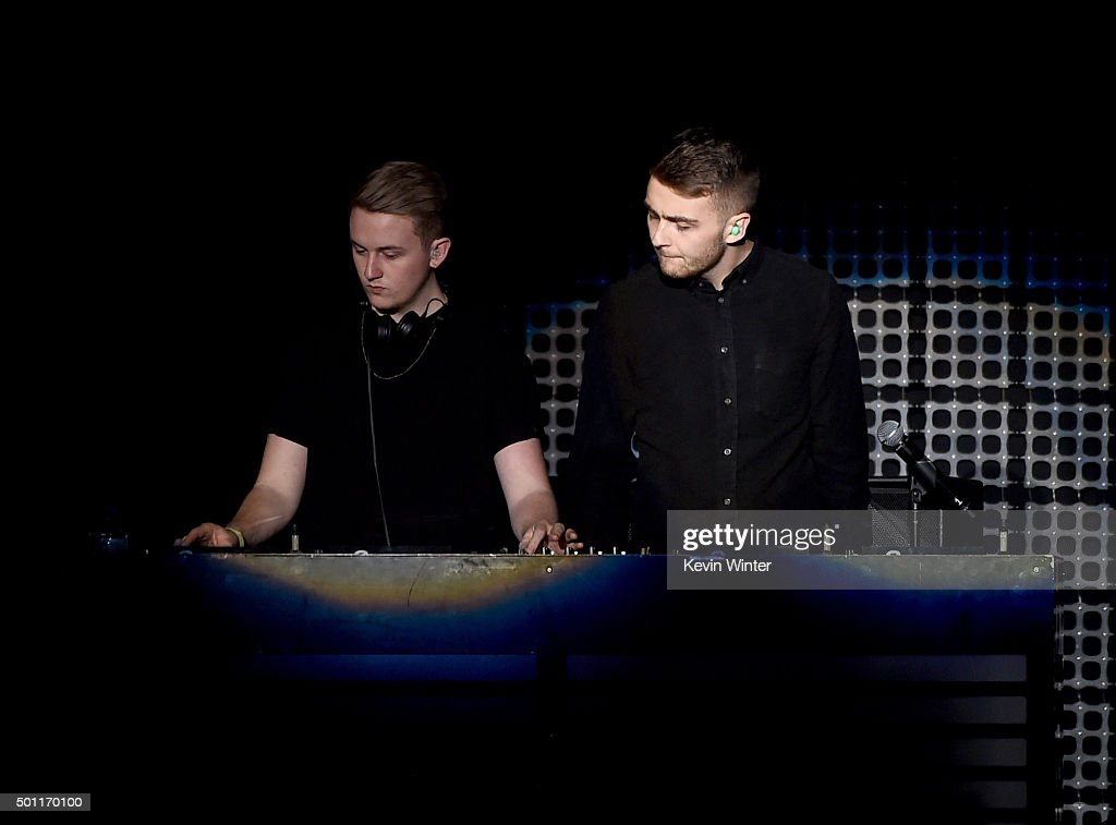 DJs Guy Lawrence (L) and Howard Lawrence of Disclosure perform onstage during 106.7 KROQ Almost Acoustic Christmas 2015 at The Forum on December 12, 2015 in Los Angeles, California.