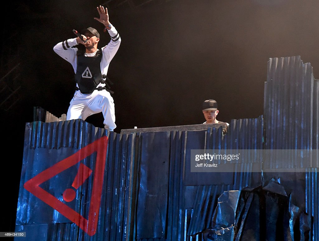 DJs J2K (L) and Autobot of Flosstradamus perform onstage during day 2 of the 2015 Coachella Valley Music & Arts Festival (Weekend 1) at the Empire Polo Club on April 11, 2015 in Indio, California.