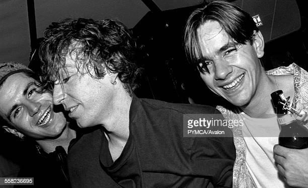 LR DJs Jon da Silva Mike Pickering and Laurent Garnier hangout in the DJ booth at HOT at the Hacienda Manchester 1988