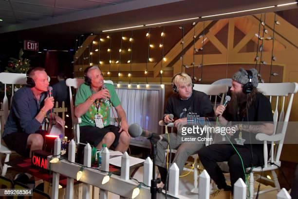 KROQ DJs Kevin Ryder Gene 'Bean' Baxter interview Spencer Cross and Judah Akers of Judah The Lion backstage during KROQ Almost Acoustic Christmas...