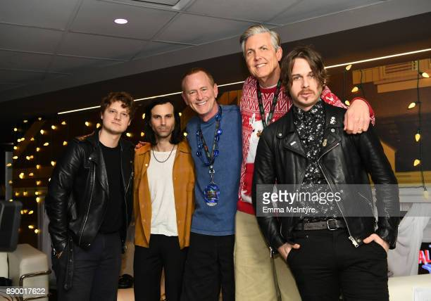 DJs Kevin Ryder Gene 'Bean' Baxter pose backstage with Isom Innis Sean Cimino and Mark Foster of Foster the People pose backstage KROQ Almost...