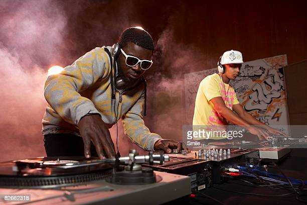 2 djs mixing music on the decks - dj stock pictures, royalty-free photos & images