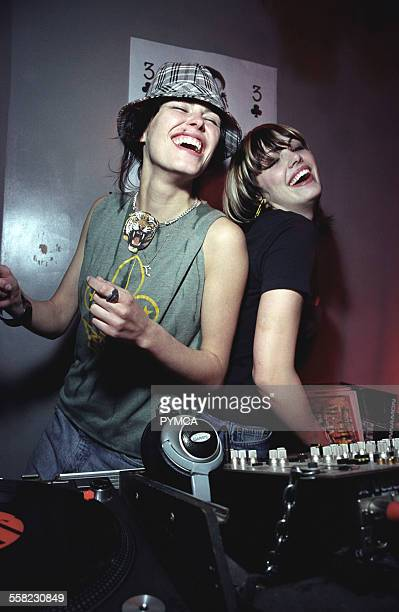 DJs Queens of Noize laughing by a set of decks UK 2000's