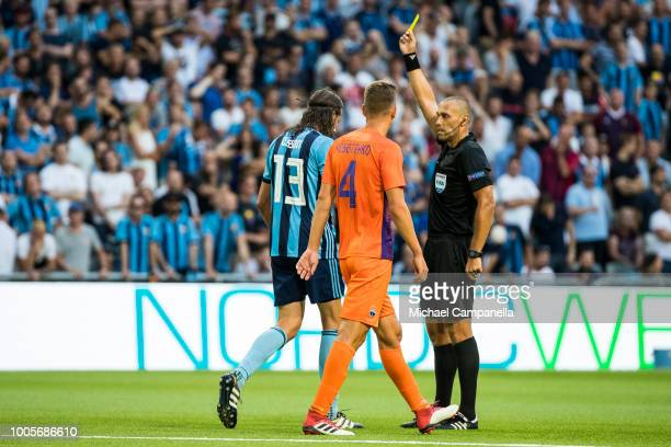 Djurgarden defender Jonas Olsson receives a yellow card during a UEFA Europa League second qualifying round match between Djurgardens IF and FC...