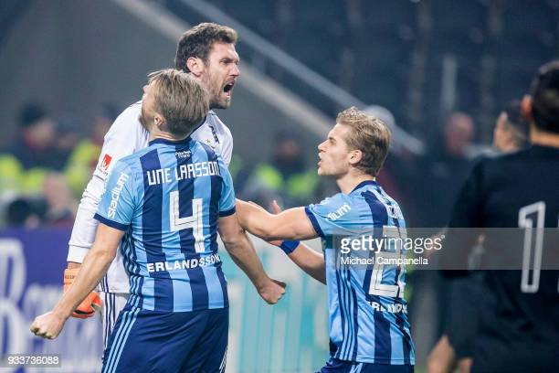 Djurgarden IF goalkeeper Andreas Isaksson reacts after saving penalty late in second half during a semifinal match of the Swedish Cup between AIK and...