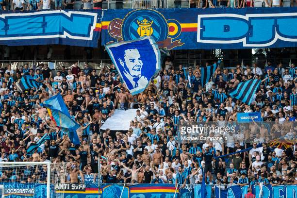 Djurgarden supporters cheer for their team during a UEFA Europa League second qualifying round match between Djurgardens IF and FC Mariupol at Tele2...