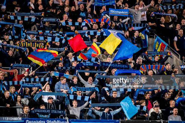 Djurgarden supporters wave flags during a semi-final match in the Swedish Cup between Djurgardens IF and BK Hacken at Tele2 Arena on March 16, 2019...