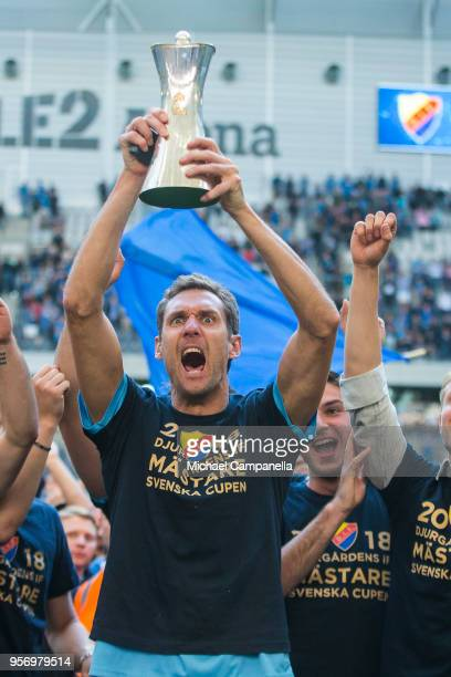 Djurgardens IF goalkeeper Andreas Isaksson raises the Swedish Cup as his teammates celebrate winning the Svenska Cupen Final between Djurgardens IF...