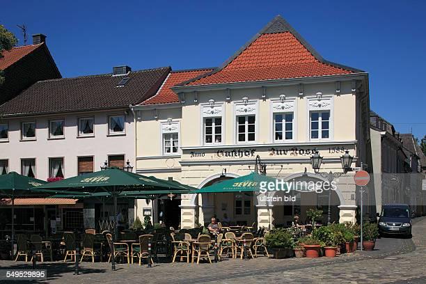 DKrefeld Rhine Lower Rhine Rhineland North RhineWestphalia NRW DKrefeldHuels market place hotel Zur Rose restaurant sidewalk cafe