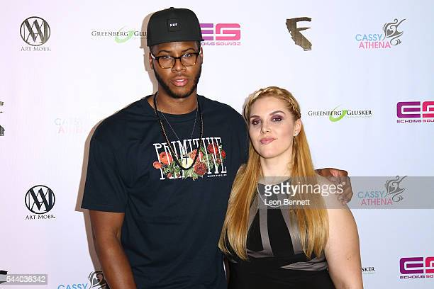 League player Reynaldo Juarez and Photographer Cassy Athena attends the EMotion Art Show on June 30 2016 in Los Angeles California