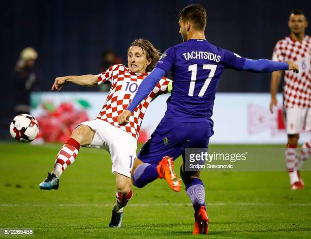 DLuka Modric of Croatia competes for the ball against Panagiotis Tachtsidis of Greece during the FIFA 2018 World Cup Qualifier PlayOff First Leg...