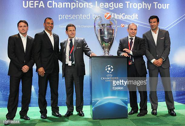 Dmitri Alenichev Cafu Gianni Franco Papa Michail Alexeev Luis Figo poses for photo after a press conference during the UEFA Champions League Trophy...