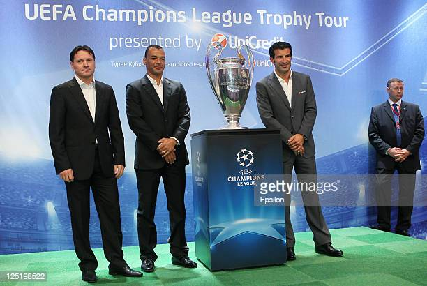 Dmitri Alenichev Cafu Luis Figo poses for photo before a press conference during the UEFA Champions League Trophy Tour 2011 on September 16 2011 in...