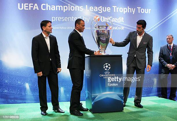 Dmitri Alenichev Cafu Luis Figo with a Trophy before a press conference during the UEFA Champions League Trophy Tour 2011 on September 16 2011 in St...