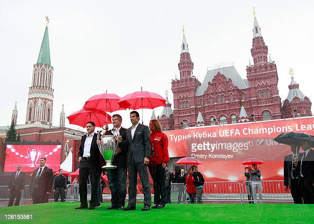 Dmitri Alenichev Davor Suker Luis Figo poses for photo during the UEFA Champions League Trophy Tour 2011 on September 23 2011 in Moscow Russia