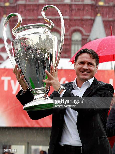 Dmitri Alenichev holds the trophy during the UEFA Champions League Trophy Tour 2011 on September 23 2011 in Moscow Russia