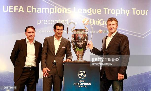 Dmitri Alenichev Luis Figo and Davor Suker poses for photo during the UEFA Champions League Trophy Tour 2011 on September 23 2011 in Moscow Russia