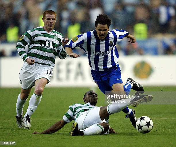 Dmitri Alenichev of FC Porto is tackled by Didier Agathe of Celtic during the UEFA Cup Final match held on May 21 2003 at the Estadio Olimpico in...