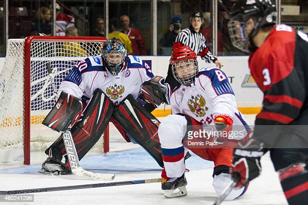 Dmitri Alexeyev and Vladislav Sukhachyov of Russia defend the net against Jake Bean of Canada Black during the World Under17 Hockey Challenge on...