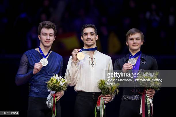 Dmitri Aliev of Russia Javier Fernandez of Spain and Mikhail Kolyada of Russia pose in the Men's medal ceremony during day three of the European...