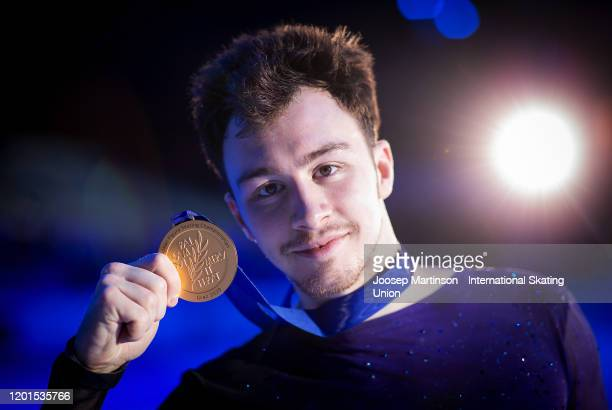 Dmitri Aliev of Russia poses in the Men's medal ceremony during day 2 of the ISU European Figure Skating Championships at Steiermarkhalle on January...