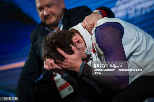 Dmitri Aliev of Russia reacts at the kiss and cry in the Men's Free Skating during day 2 of the ISU European Figure Skating Championships at...