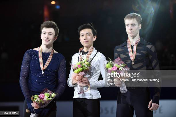Dmitri Aliev of Russia Vincent Zhou of the USA and Alexander Samarin of Russia pose on the podium during the 2nd day of the World Junior Figure...