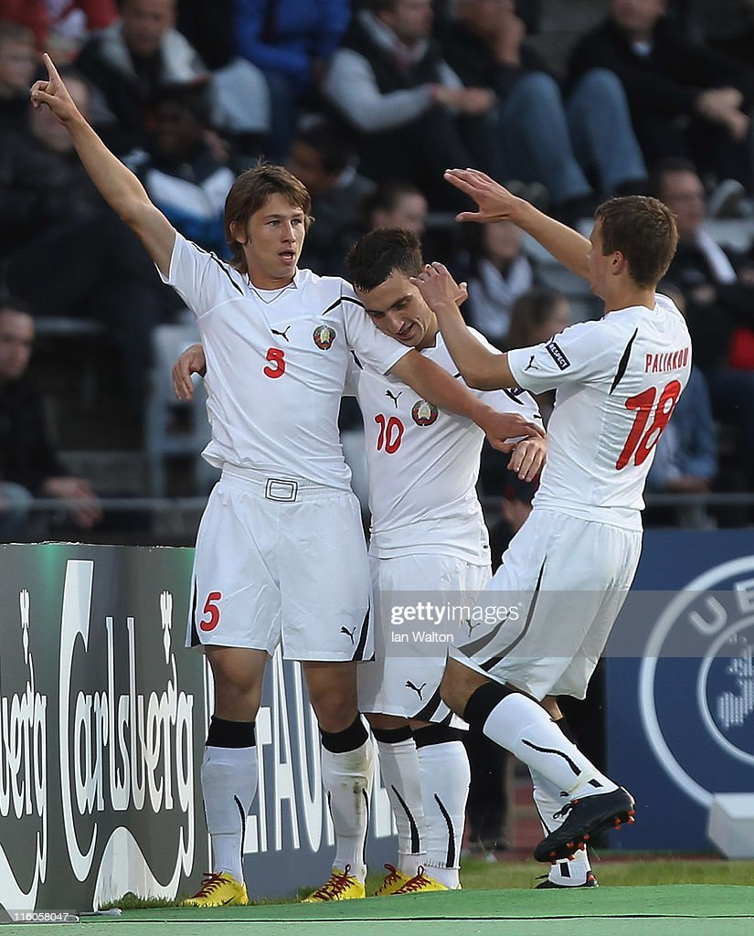 Dmitri Baga (L) of Belarus celebrates with team-mates Vladimir Yurchenko (C) and Denis Polyakov after scoring the opening goal of the UEFA European Under-21 Championship Group A match between Denmark and Belarus at the Aarhus stadium on on June 14, 2011 in Aarhus, Denmark.