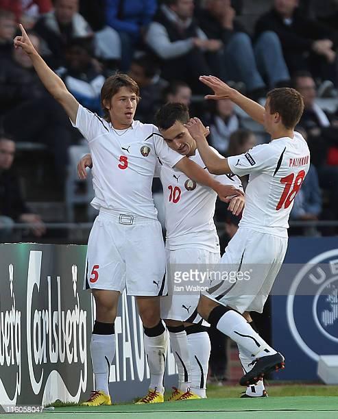 Dmitri Baga of Belarus celebrates with teammates Vladimir Yurchenko and Denis Polyakov after scoring the opening goal of the UEFA European Under21...