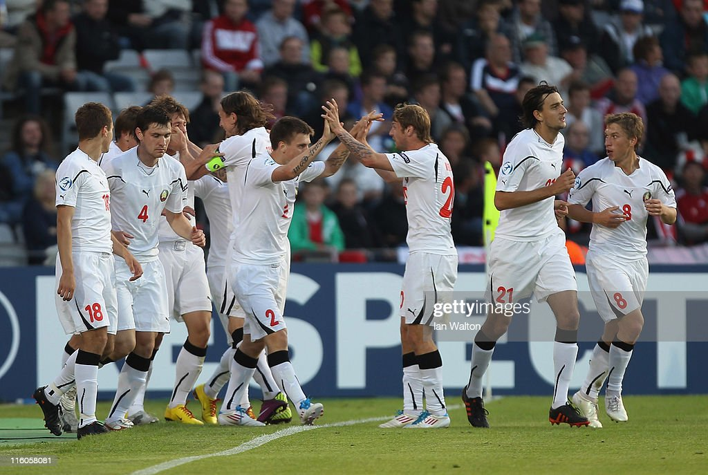 Dmitri Baga (4th L) of Belarus is congratulated by team-mates after scoring the opening goal of the UEFA European Under-21 Championship Group A match between Denmark and Belarus at the Aarhus stadium on on June 14, 2011 in Aarhus, Denmark.