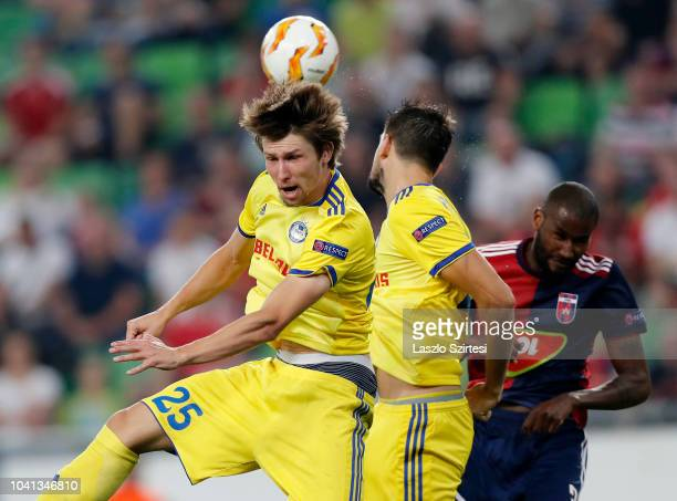 Dmitri Baga of FC BATE Borsiov needs the ball next to Yegor Filipenko of FC BATE Borsiov and Paulo Vinicius of Vidi FC during the UEFA Europa League...
