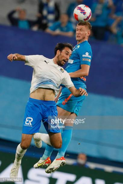 Dmitri Chistyakov of Zenit and Ivelin Popov of Sochi vie for a header during the Russian Premier League match between FC Zenit Saint Petersburg and...
