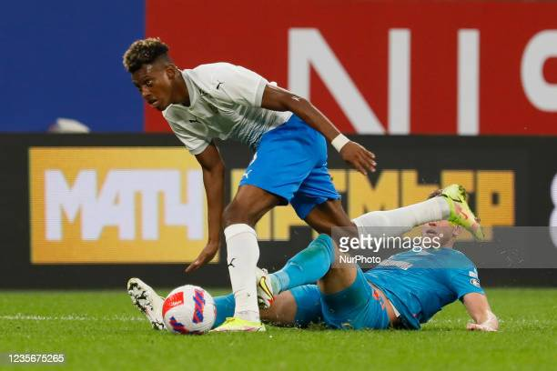 Dmitri Chistyakov of Zenit and Mateo Cassierra of Sochi vie for the ball during the Russian Premier League match between FC Zenit Saint Petersburg...
