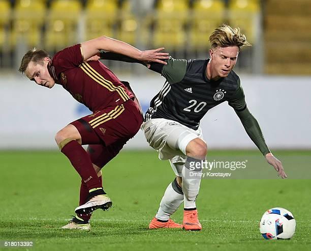 Dmitri Efremov of Russia U21 challenged by Yannick Gerhardt of Germany U21 during the 2017 UEFA European U21 Championships qualifier match between...