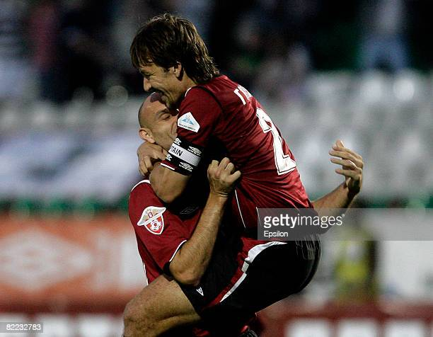 Dmitri Godunok and Mariush Yop of FC Moscow celebrate their victory in the Russian Football League Championship match between FC Moscow and FC Tom...