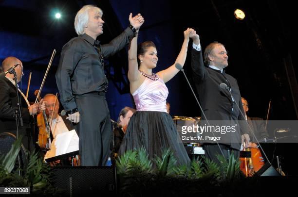 Dmitri Hvorostovsky Anna Netrebko and Valery Gergiev perform on stage at Ksnigsplatz Open Air on July 10 2009 in Munich Germany