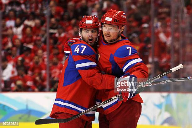 Dmitri Kalinin of Russia celebrates with Alexander Radulov after scoring against Canada during the ice hockey men's quarter final game between Russia...
