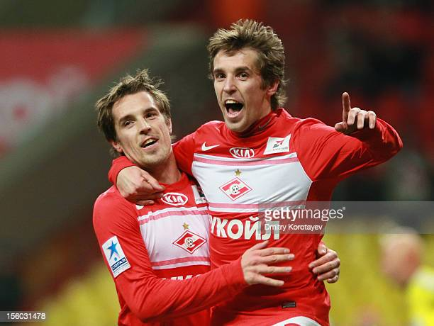 Dmitri Kombarov and Kirill Kombarov of FC Spartak Moscow celebrate after scoring a goal during the Russian Premier League match between FC Spartak...