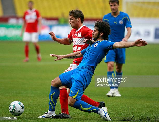 Dmitri Kombarov of FC Spartak Moscow battles for the ball with Anri Khagush of FC Rostov RostovonDon during the Russian Football League Championship...