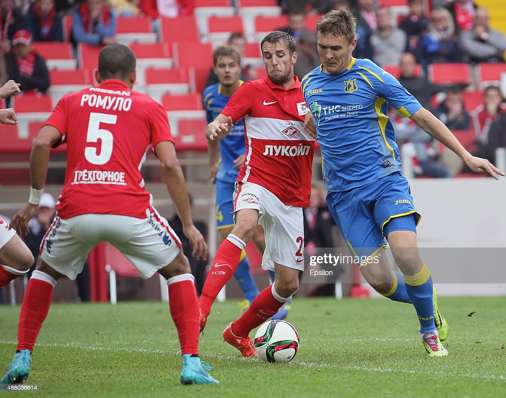 Dmitri Kombarov (C) of FC Spartak Moscow challenged by Aleksandr Bukharov of FC Rostov Rostov-on-Don during the Russian Premier League match between FC Spartak Moscow v FC Rostov Rostov on Don at the Arena Otkritie stadium on September 13, 2015 in Moscow, Russia.