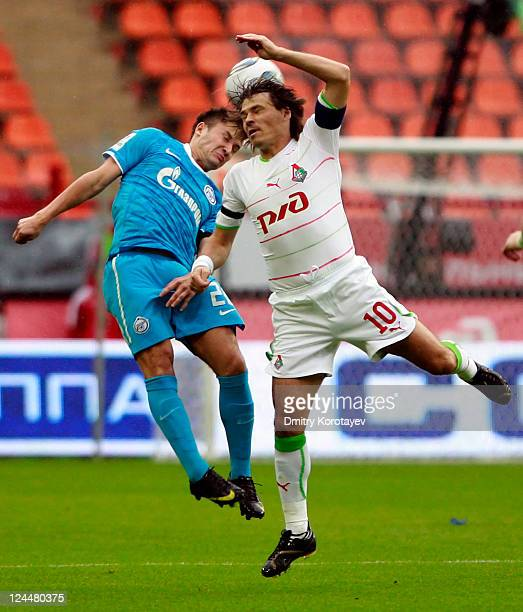 Dmitri Loskov of FC Dynamo Moscow battles for the ball with Viktor Fayzulin of FC Zenit St Petersburg during the Russian Premier League match between...