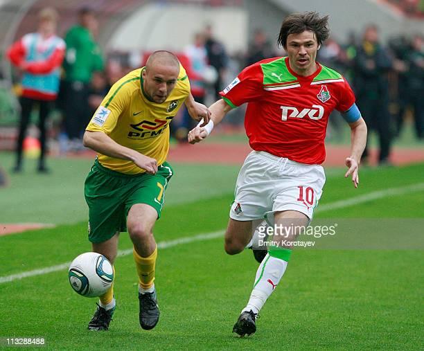 Dmitri Loskov of FC Lokomotiv Moscow battles for the ball with Vladislav Kulik of FC Kuban Krasnodar during the Russian Football League Championship...