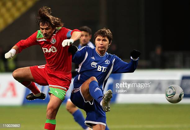 Dmitri Loskov of FC Lokomotiv Moscow battles for the ball with Aleksandr Sapeta of FC Dynamo Moscow during the Russian Football League Championship...